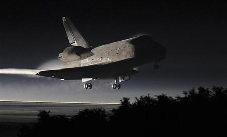 Space shuttle Atlantis lands at the Kennedy Space Center in Cape Canaveral, Florida, July 21, 2011. The space shuttle Atlantis glided home through a moonlit sky for its final landing at the Kennedy Space Center in Florida on Thursday, completing a 30-year odyssey for NASA's shuttle fleet. REUTERS/Don Emmert/Pool