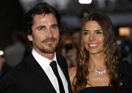 British actor Christian Bale and his wife Sibi pose for photographers as they arrive at the European Premiere of ''The Dark Knight Rises'' in Leicester Square, central London, July 18, 2012. REUTERS/Andrew Winning
