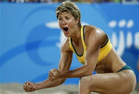 Natalie Cook of Australia celebrates scoring a point against Georgia during the women's preliminary round beach volleyball match at the Beijing 2008 Olympic Games, August 11, 2008. REUTERS/Carlos Barria