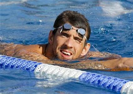 Member of U.S. national Olympic swimming team Michael Phelps looks on during a training session for the London 2012 Olympics, in Bellerive July 21, 2012. REUTERS/Robert Pratta