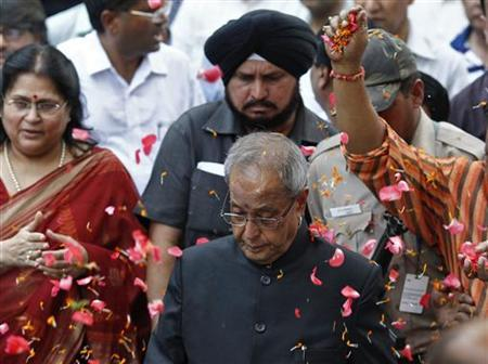 Supporters scatter flower petals on newly elected India's President Pranab Mukherjee (C) in New Delhi July 22, 2012. REUTERS/Adnan Abidi