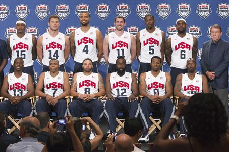 U.S. basketball Chairman Jerry Colangelo (R) and the 12 players selected for the 2012 U.S. Olympic men's basketball team pose during a news conference at the Wynn Las Vegas Resort in Las Vegas, Nevada in a July 7, 2012 file photo. REUTERS/Steve Marcus/files