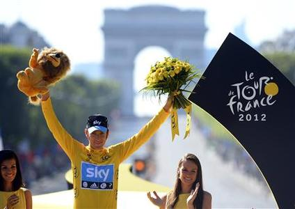 Sky Procycling rider and leader's yellow jersey Bradley Wiggins of Britain celebrates his overall victory on the podium after the final 20th stage of the 99th Tour de France cycling race between Rambouillet and Paris, July 22, 2012. REUTERS/Jerome Prevost/Pool