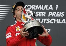 Ferrari Formula One driver Fernando Alonso of Spain kisses the winner's trophy after winning the German F1 Grand Prix at the Hockenheimring in Hockenheim July 22, 2012. REUTERS/Wolfgang Rattay