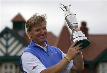 Ernie Els of South Africa holds up the Claret Jug after winning at the British Open golf championship at Royal Lytham & St Annes, northern England July 22, 2012. REUTERS/Phil Noble
