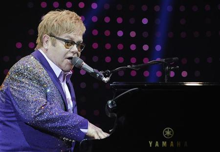 British singer Elton John performs during a concert as part of his ''Greatest hits Live 2012'' world tour at the Ondrej Nepela Arena in Bratislava July 10, 2012. REUTERS/Radovan Stoklasa