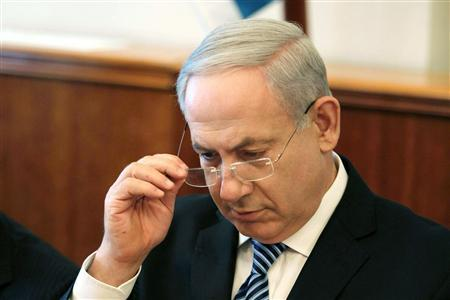 Israel's Prime Minister Benjamin Netanyahu opens the weekly cabinet meeting at his office in Jerusalem July 22, 2012. REUTERS/Gali Tibbon/Pool