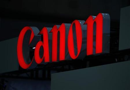 A logo of Canon Inc is pictured at the 3D and Virtual Reality Expo in Tokyo June 20, 2012. The expo which showcases the latest technology will be held until June 22. REUTERS/Yuriko Nakao