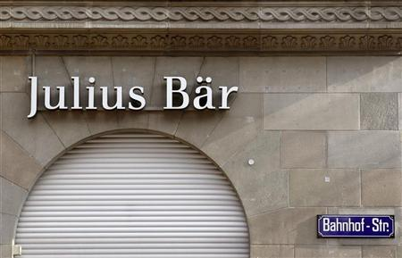 The logo of Swiss bank Julius Baer is pictured at the company's headquarters at the Bahnhofstrasse in Zurich February 6, 2012. REUTERS/Arnd Wiegmann