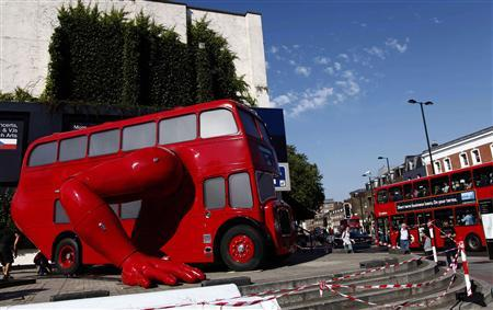 A London bus that has been transformed into a robotic sculpture by Czech artist David Cerny is assembled in front of the Czech Olympic headquarters in London July 22, 2012. REUTERS/Marika Kochiashvili