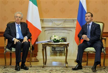 Russian Prime Minister Dmitry Medvedev (R) meets his Italian counterpart Mario Monti in Moscow July 23, 2012. REUTERS/Alexander Astafev/RIA Novosti/Pool