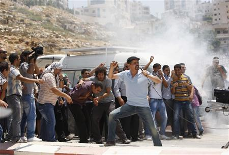 Actors play the role of Palestinian protesters during filming on the set of feature-length film ''Palestine Stereo'' in the West Bank city of Ramallah July 18, 2012. REUTERS/Mohamad Torokman