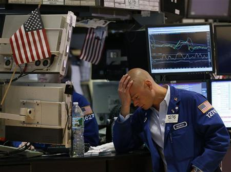 Trader Mario Picone works on the floor of the New York Stock Exchange in this June 1, 2012 file photo. REUTERS/Brendan McDermid/Files.