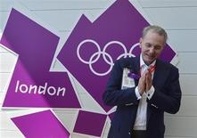 President of the International Olympic Commission, Jacques Rogge, gestures during a tour of the Athletes Village at the Olympic Park in Stratford in east London July 23, 2012. REUTERS/Toby Melville