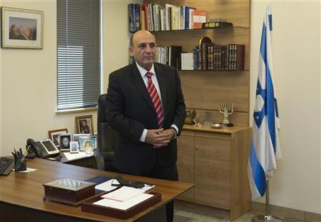 Shaul Mofaz, head of the centrist Kadima party, poses for a photo in his office at parliament in Jerusalem, before he was sworn in as a cabinet minister May 9, 2012. REUTERS/Ronen Zvulun
