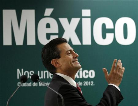Mexico's President-elect Enrique Pena Nieto gestures during a news conference in Mexico City July 18, 2012. REUTERS/Henry Romero