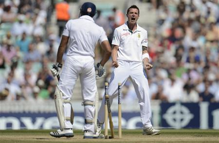 South Africa's Dale Steyn celebrates after the dismissal of England's Ravi Bopara (L) during their first cricket test match at the Oval cricket ground in London July 23, 2012. REUTERS/Philip Brown