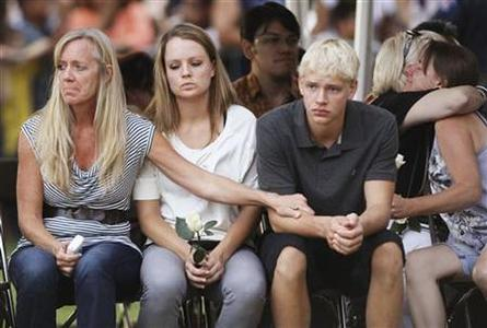 Family members of victims killed in last Friday's Century 16 movie theater shootings, grieve at a prayer vigil in Aurora, Colorado July 22, 2012. REUTERS/Rick Wilking