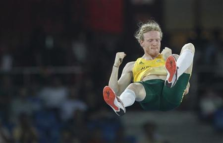 Australia's Steve Hooker reacts after successfully clearing the bar during the men's pole vault finals at the Commonwealth Games in New Delhi October 11, 2010. REUTERS/Adnan Abidi