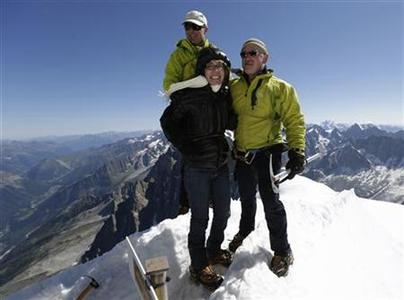 Former U.S. Congresswoman Gabrielle Giffords (C) stands with her husband Mark Kelly (R), NASA astronaut and commander of mission STS-134, and mountain guide Vincent Lameyre before Kelly and two other astronauts walk from L'Aiguille du Midi to the Refuge des Cosmiques near Mont-Blanc in Chamonix July 23, 2012. REUTERS/Denis Balibouse