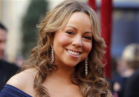 Singer Mariah Carey arrives at the 82nd Academy Awards in Hollywood in this March 7, 2010 file photo. Pop star Carey will join Fox television's ''American Idol'' singing competition as a new judge next season, network executive Kevin Reilly said on July 23, 2012. REUTERS/Brian Snyder/Files