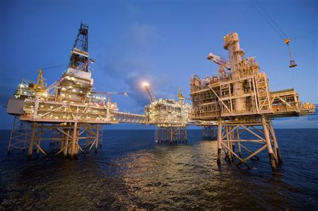 Early evening photos of Nexen's Galaxy III offshore rigs with the newly installed fourth platform in the foreground in the North Sea is pictured in this May 2010 aerial view handout photo. REUTERS/Nexen Inc./ Handout