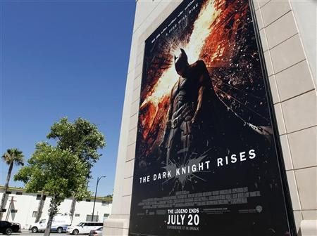A poster for the Warner Bros. film ''The Dark Knight Rises'' is displayed at Warner Bros. REUTERS/Fred Prouser