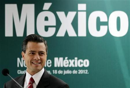 Mexico's President-elect Enrique Pena Nieto smiles during a news conference in Mexico City July 18, 2012. REUTERS/Henry Romero