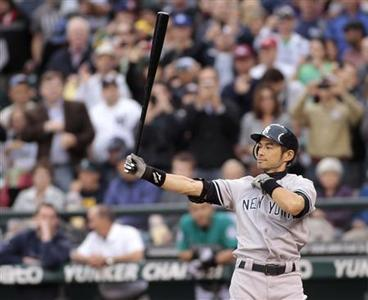 Former Seattle Mariners player Ichiro Suzuki prepares his first at bat in the third inning after being traded to the New York Yankees, July 23, 2012, before their MLB American League baseball game in Seattle, Washington. REUTERS/Robert Sorbo