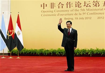 China's President Hu Jintao waves upon arrival for a group photo session during the opening ceremony for the Fifth Ministerial Conference of the Forum on China-Africa Cooperation (FOCAC) at the Great Hall of the People in Beijing July 19, 2012. REUTERS/Andy Wong/Pool