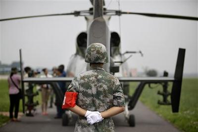 China plays cards close to chest in military transpare...