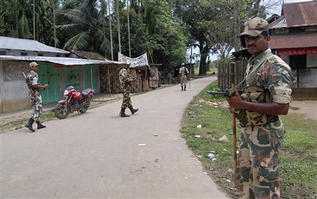 Indian security personnel patrol on a street during curfew near Kokorajhar town in the northeastern Indian state of Assam July 22, 2012. REUTERS-Stringer