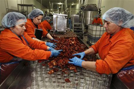 Workers put sun-dried tomatoes in glass jars at the Gaea food company in the central Greek town of Agrinio, some 280km (174 miles) southwest of Athens February 28, 2012. REUTERS/Yorgos Karahalis