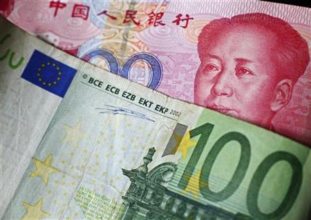 A 100 Euro banknote is placed on top of a 100 yuan banknote in this picture illustration taken in Beijing, November 7, 2010. REUTERS/Petar Kujundzic