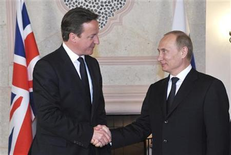 Russia's President Vladimir Putin (R) shakes hands with Britain's Prime Minister David Cameron during their meeting before the G20 summit in Los Cabos June 18, 2012. REUTERS/Aleksey Nikolskyi/RIA Novosti/Pool