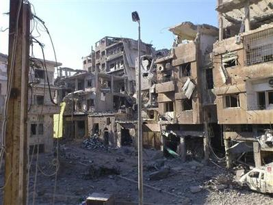 Damaged buildings are seen at juret al-Shayah in Homs July 23, 2012. Picture taken July 23, 2012. REUTERS/Shaam News Network/Handout