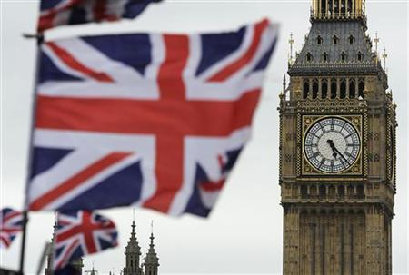 Flags are seen above a souvenir kiosk near Big Ben clock at the Houses of Parliament in central London June 26, 2012. Britain's landmark Big Ben clock tower adjoining the Houses of Parliament will be renamed ''Elizabeth Tower'' to mark Queen Elizabeth's 60th year on the throne, a parliamentary official said on Tuesday. REUTERS/Paul Hackett