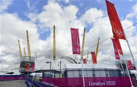 Olympics banners and flags are seen beside the North Greenwich Arena at Greenwich in London July 21, 2012. REUTERS/Toby Melville