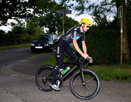 The day after winning the Tour De France Britain's Bradley Wiggins cycles on the road near his home in Eccleston ahead of the London 2012 Olympics, northern England July 23, 2012. REUTERS/Nigel Roddis