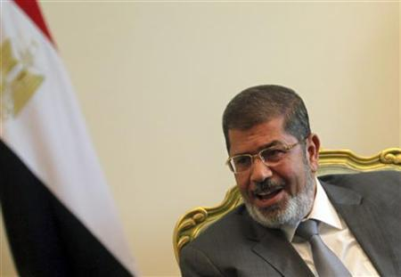 Egypt's president Mohamed Mursi attends a meeting with Hamas leader Khaled Meshaal at the presidential palace in Cairo July 19, 2012. REUTERS/Amr Abdallah Dalsh