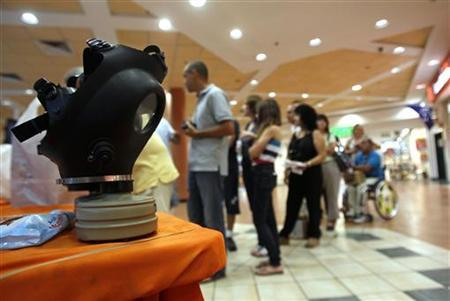 People queue to receive gas mask kits at a distribution point in a shopping mall in the town of Mevasseret Zion, near Jerusalem July 24, 2012. REUTERS/Baz Ratner