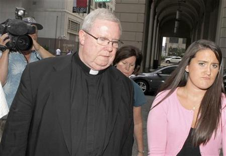 Monsignor William Lynn (L) walks to the courthouse to hear the verdict in his sexual abuse trial in Philadelphia, Pennsylvania, June 22, 2012. REUTERS/Tim Shaffer