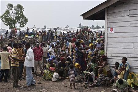 Recent arrivals who fled fighting wait for registration at Magunga III camp, outside the eastern Congolese city of Goma, July 23, 2012. REUTERS/Alissa Everett