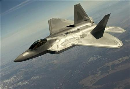 A F-22 Raptor fighter jet flies in a training mission during Red Flag 12-3 over the Nevada Test and Training Range in this March 13, 2012 handout photo courtesy of the U.S. Air Force. REUTERS/U.S. Air Force/Staff Sgt. Christopher Hubenthal/Handout