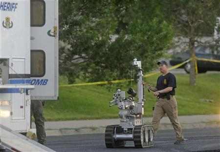 The Aurora bomb squad robot is deployed to search a suspect's car behind the Century 16 Theatre following a shooting during a ''Batman'' movie screening in Aurora, Colorado July 20, 2012. REUTERS/Evan Semon