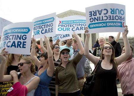 Supporters of the Affordable Healthcare Act celebrate in front of the Supreme Court after the court upheld the legality of the law in Washington June 28, 2012. REUTERS/Joshua Roberts