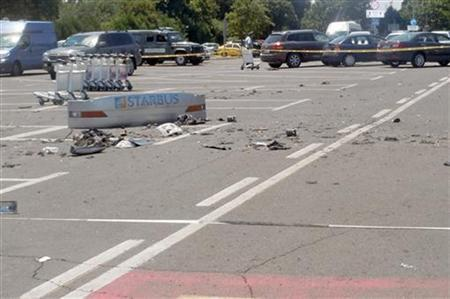 Debris from a bus that was damaged in a bomb blast on Wednesday is seen outside Burgas Airport, about 400km (248miles) east of Sofia July 19, 2012. REUTERS/Interior Ministry/Handout