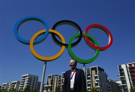 President of the International Olympic Commission, Jacques Rogge stands near Olympic rings during a tour of the Athletes Village at the Olympic Park in Stratford in east London July 23, 2012. REUTERS/Toby Melville