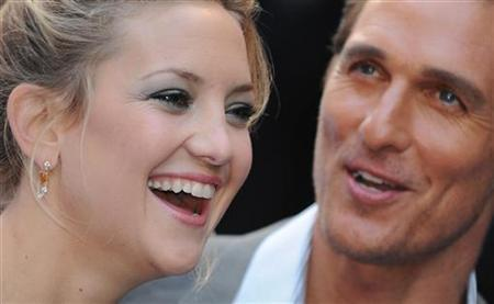 U.S. actress Kate Hudson and actor Matthew McConaughey pose for photographers as they arrive for the premiere of the film 'Fool's Gold' at Leicester Square in London April 10, 2008. REUTERS/Toby Melville