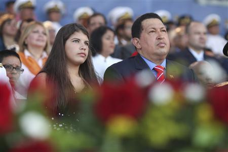 Venezuelan President Hugo Chavez (R) attends a ceremony to commemorate Navy Day in Puerto Cabello, at the state of Carabobo July 24, 2012. REUTERS/Miraflores Palace/Handout